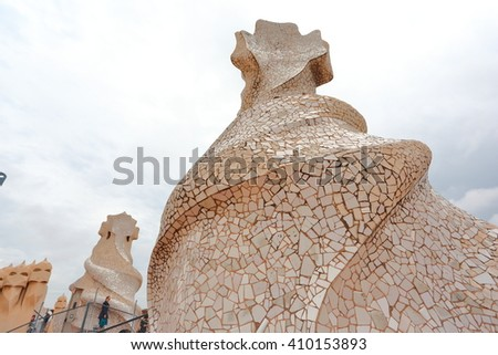 BARCELONA - Oct 20 2015: Casa Mila popularly known as La Pedrera is a modernist building in Barcelona, Catalonia, Spain. It was the last civil work designed by Catalan architect Antoni Gaudi.  - stock photo