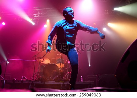 BARCELONA - OCT 20: Future Islands (synthpop electronic dance band) performs at Razzmatazz stage on October 20, 2014 in Barcelona, Spain. - stock photo