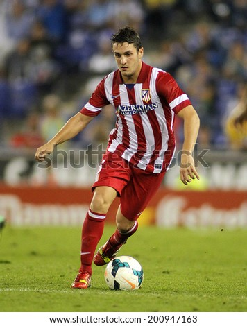 BARCELONA - OCT, 19: Koke Resurreccion of Atletico de Madrid in action during a Spanish League match against RCD Espanyol at the Estadi Cornella on October 19, 2013 in Barcelona, Spain - stock photo