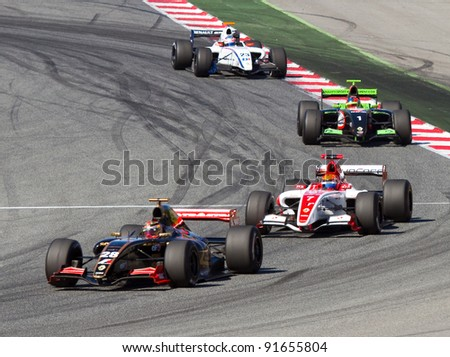 BARCELONA - OCTOBER 9: Brendon Hartley (28), Alexander Rossi (7) and Kevin Korjus (1) race at Formula Renault 3.5 World Series, on October 9, 2011, in Circuit de Catalunya, Barcelona, Spain. - stock photo