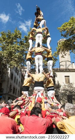 BARCELONA - OCTOBER 11: castellers making a Castell or Human Tower during Sarria neighborhood festivities, on October 11, 2014 in Barcelona, Spain.   - stock photo