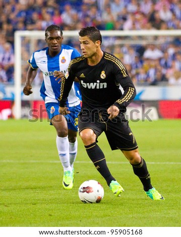 BARCELONA - OCTOBER 2: Cristiano Ronaldo (R) in action during the Spanish League match between Espanyol and Real Madrid, final score 0 - 4, on October 2, 2011 in Cornella stadium, Barcelona, Spain. - stock photo