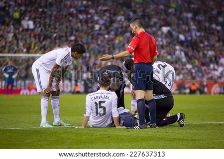 BARCELONA - OCTOBER 29: Doctors with injured player at the Copa del Rey match between UE Cornella and Real Madrid, final score 1 - 4, on October 29, 2014, in Cornella, Barcelona, Spain. - stock photo