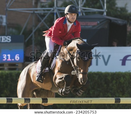 BARCELONA - OCTOBER 09: Kent Farrington rider in action during the Furusiyya Jumping First Competition in Real Club Polo Barcelona, on October 09, 2014, Barcelona, Spain.  - stock photo