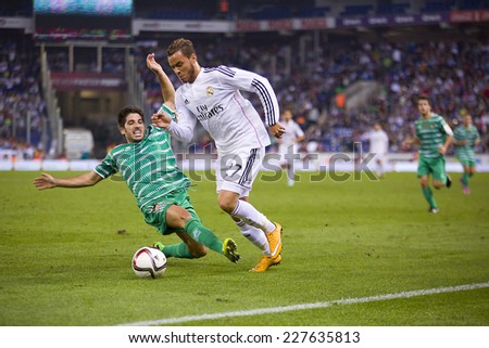 BARCELONA - OCTOBER 29: Raul de Tomas of RM (R) in action at the Copa del Rey match between UE Cornella and Real Madrid, final score 1 - 4, on October 29, 2014, in Cornella, Barcelona, Spain. - stock photo