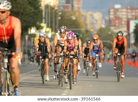 BARCELONA - OCTOBER 18 : Unidentified competitors in action during Barcelona Triathlon 2009 Event October 18, 2009 in Barcelona, Spain. - stock photo