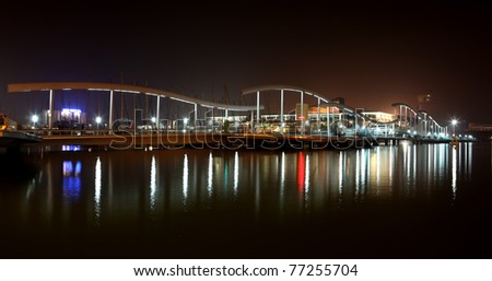 Barcelona port view of the night landscape lights water reflection - stock photo