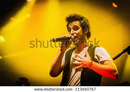 "BARCELONA - SEP 21: Alex Pla leader of spanish catalan band Amelie performs at the ""Hard Rock Rocks La Merce"" concert within La Merce celebrations on September 21, 2012 in Barcelona, Spain - stock photo"