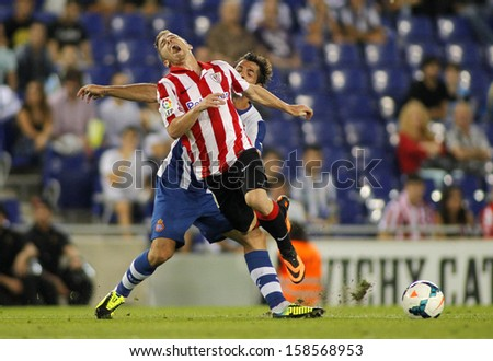 BARCELONA - SEP, 23: Iker Muniain of Athletic Bilbao in action during a Spanish League match between RCD Espanyol vs Bilbao at the Estadi Cornella on September 23, 2013 in Barcelona, Spain - stock photo