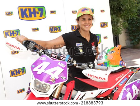 BARCELONA - SEPT, 15: Enduro World Champion Laia Sanz, during the presentation of her motorbike at the Museu Colet on September 15, 2014 in Barcelona - stock photo