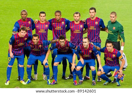 BARCELONA - SEPTEMBER 13: Barcelona players pose for a photo before the Champions League match between FC Barcelona and AC Milan, final score 2 - 2, on September 13, 2011, in Camp Nou stadium, Barcelona, Spain. - stock photo