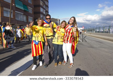 BARCELONA - SEPTEMBER 11: Catalans made a 400 km human chain to show their desire for independence from Spain, on Sept. 11, 2013 in Barcelona, Spain. More than 1 million people took part in the event. - stock photo