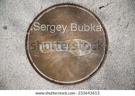 BARCELONA - SEPTEMBER 27, 2014: Footprint of Sergey Bubka in front of the Olympic stadium in Barcelona. Sergey Bubka is a former Ukrainian pole vaulter. - stock photo