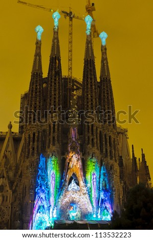 BARCELONA -Â?Â? SEPTEMBER 22: La Sagrada Familia, cathedral designed by Gaudi, with special illumination to commemorate La Merce a traditional Barcelona holiday, on September 22, 2012, Barcelona, Spain. - stock photo