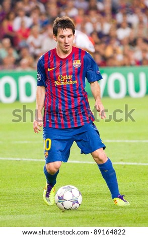 BARCELONA - SEPTEMBER 13: Leo Messi in action during the UEFA Champions League match between FC Barcelona and AC Milan, final score 2 - 2, on September 13, 2011, in Barcelona, Spain. - stock photo