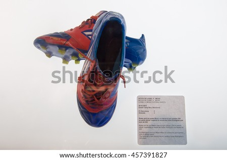 BARCELONA - SEPTEMBER 22, 2014: Lionel Messi football boots at the FC Barcelona museum. He scored his goal number 234 on official match. Camp Nou, Barcelona, Spain. - stock photo