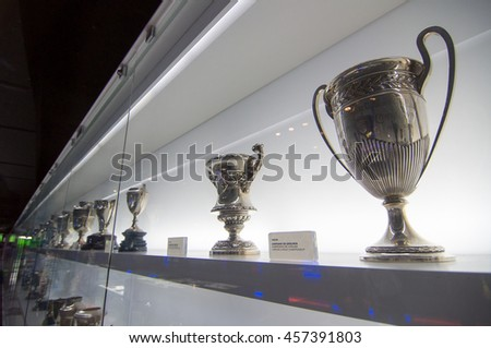 BARCELONA - SEPTEMBER 22, 2014: One of the trophy galleries at the FC Barcelona museum. Catalan League Championship Cup. Camp Nou, Barcelona, Spain. - stock photo