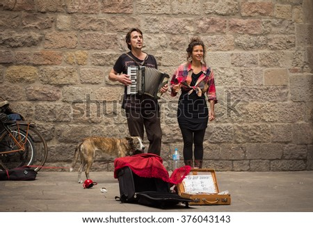 Barcelona, SPAIN - APR, 25: young buskers with dog playing music on streets of Barcelona on April, 25, 2014 in Barcelona, Spain - stock photo