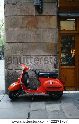 Barcelona, Spain - April 04, 2016: Old Vespa parked on old street in Barcelona,Spain                    - stock photo