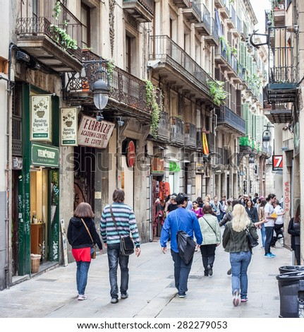 BARCELONA, SPAIN - APRIL, 2015: People strolling in Gothic Quarter in Barcelona - stock photo