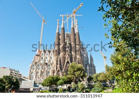BARCELONA, SPAIN - APRIL 28, 2015: Sagrada Familia is a Roman Catholic church in Barcelona, designed by Catalan architect Antoni Gaudi. Is not finished yet  - stock photo