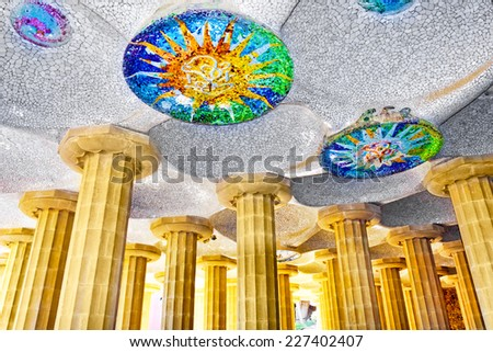 BARCELONA, SPAIN- AUGUST 28, 2008:Gorgeous and amazing Park Guel in Barcelona. Park Guell (1914) is the famous architectural town art designed by Antoni Gaudi.  - stock photo