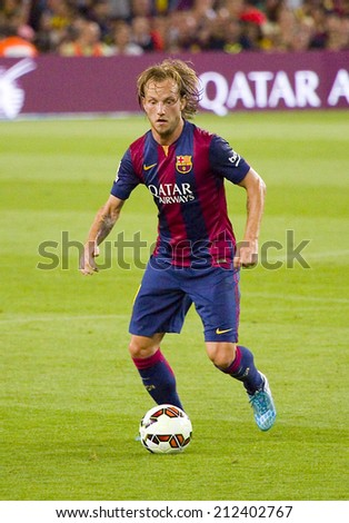 BARCELONA, SPAIN - AUGUST 18: Ivan Rakitic of FCB in action at Gamper friendly match between FC Barcelona and Club Leon FC, final score 6-0, on August 18, 2014, in Camp Nou, Barcelona, Spain. - stock photo
