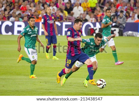 BARCELONA, SPAIN - AUGUST 18: Leo Messi of FCB (10) in action at Gamper friendly match between FC Barcelona and Club Leon FC, final score 6-0, on August 18, 2014, in Camp Nou, Barcelona, Spain. - stock photo