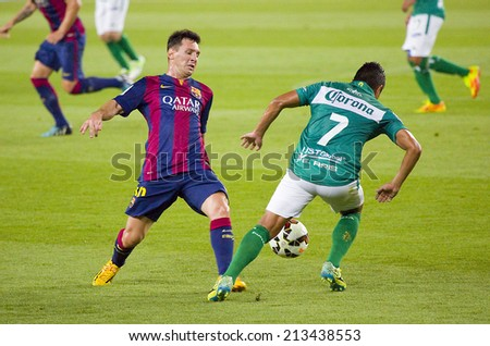 BARCELONA, SPAIN - AUGUST 18: Leo Messi of FCB (L) in action at Gamper friendly match between FC Barcelona and Club Leon FC, final score 6-0, on August 18, 2014, in Camp Nou, Barcelona, Spain. - stock photo