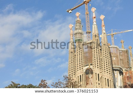 BARCELONA, SPAIN - DEC 26, 2014: La Sagrada Familia - the impressive cathedral designed by Gaudi, which is being build since Mar 19, 1882 and is not finished yet. - stock photo