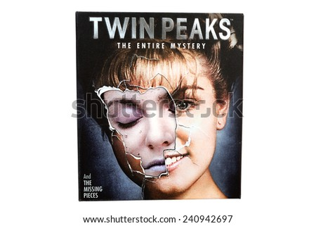 BARCELONA, SPAIN - DEC 27, 2014: Twin Peaks, American television serial drama created by Mark Frost and David Lynch, on Blu-ray disc edition, isolated on white background. - stock photo