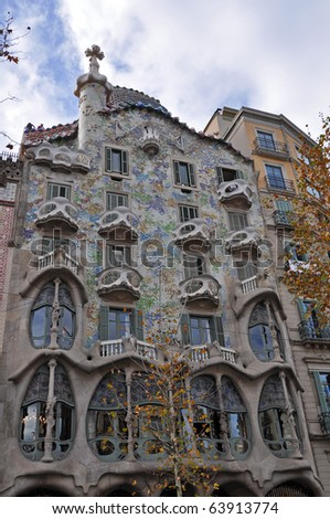 BARCELONA, SPAIN - 30 DECEMBER, 2009: Exterior of Casa Batllo on December 30, 2009, a building restored by great catalan architect Antoni Gaudi. Gaudi avoids straight lines completely. - stock photo