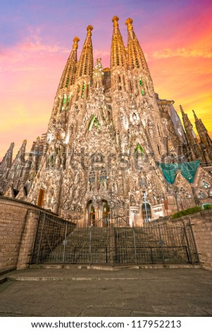 BARCELONA, SPAIN - DECEMBER 14: La Sagrada Familia - the impressive cathedral designed by Gaudi, which is being build since 19 March 1882 and is not finished yet December 14, 2009 in Barcelona, Spain. - stock photo