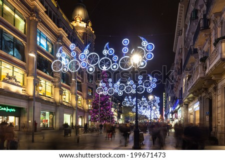 BARCELONA, SPAIN - DECEMBER 2: Night view of Barcelona in winter on December 2, 2013 in Barcelona, Spain. Christmas decorations on Portal del Angel - stock photo