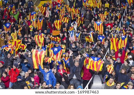 BARCELONA, SPAIN - DECEMBER 30: Some supporters at friendly match between Catalonia and Cape Verde, final score 4-1, on Decembre 30, 2013, in Olympic stadium Lluis Companys, Barcelona, Spain. - stock photo