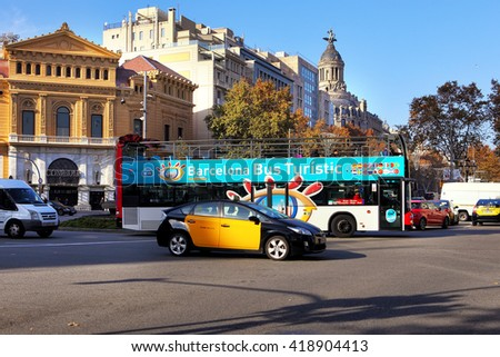 BARCELONA, SPAIN - december 11, 2015: Tourist bus in Barcelona, Spain. Barcelona City Tour is an official touristic bus service that shows the city with an audio guide. - stock photo