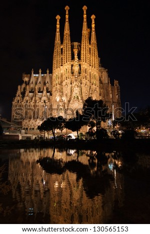 BARCELONA, SPAIN - FEBRUARY 9: The Basilica of La Sagrada Familia at night. Designed by Antoni Gaudi, its construction began in 1882 and is not finished yet on February 9, 2013 in Barcelona, Spain. - stock photo