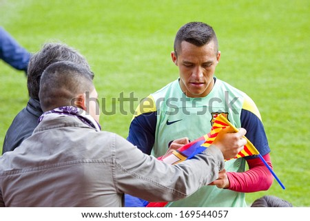 BARCELONA, SPAIN - JANUARY 3: Alexis Sanchez sign autographs at FC Barcelona team in open doors training session at Mini Estadi stadium, with 13,200 spectators, on January 3, 2014 in Barcelona, Spain. - stock photo