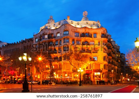 BARCELONA, SPAIN - JANUARY 2, 2014:  Casa Mila (La Pedrera) in night, Barcelona.  House was built in 1905-1910 by Catalan architect Antoni Gaudi  - stock photo