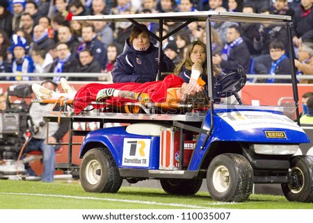 BARCELONA, SPAIN - JANUARY 8: Cristian Alvarez of RCDE being carried on a gurney during the match between RCD Espanyol and FC Barcelona, final score 1-1, on January 8, 2012, in Barcelona, Spain. - stock photo