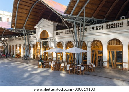 BARCELONA, SPAIN - JANUARY 21. Front side of the public market Mercat de Santa Caterina in Barcelona on January 21, 2016. Guests have lunch in the Tapas bar. The market has a nice colorful curved roof - stock photo
