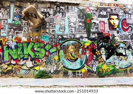 Barcelona, Spain - January 25, 2015: Graffiti on textured wall  - stock photo