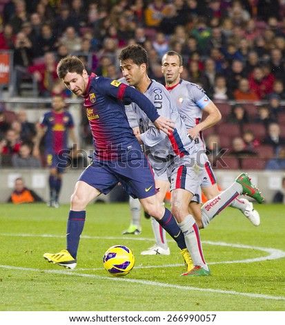 BARCELONA, SPAIN - JANUARY 27: Lionel Messi (L) of FCB in action at the Spanish League match between FC Barcelona and Osasuna, final score 5 - 1, on January 27, 2013, in Barcelona, Spain. - stock photo
