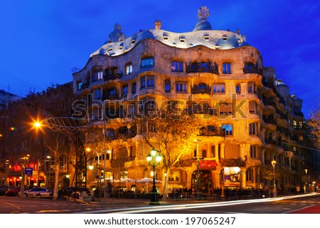 BARCELONA, SPAIN - JANUARY 2, 2014: Night view of Casa Mila (La Pedrera) in Barcelona.    - stock photo
