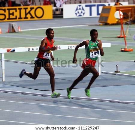 BARCELONA, SPAIN - JULY 14: athletes compete in the 5000 meters final on the 2012 IAAF World Junior Athletics Championships on July 14, 2012 in Barcelona, Spain. - stock photo