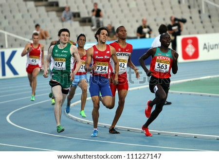 BARCELONA, SPAIN - JULY 14: athletes compete in the 800 meters semi final on the 2012 IAAF World Junior Athletics Championships on July 14, 2012 in Barcelona, Spain. - stock photo