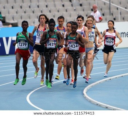 BARCELONA, SPAIN - JULY 15: Athletes compete in the 1500 metres final on the 2012 IAAF World Junior Athletics Championships on July 15, 2012 in Barcelona, Spain. - stock photo