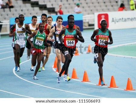 BARCELONA, SPAIN - JULY 15: Athletes compete in the 3000 metres steeplechase final on the 2012 IAAF World Junior Athletics Championships on July 15, 2012 in Barcelona, Spain. - stock photo