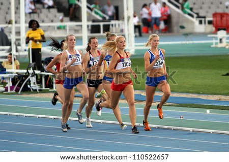 BARCELONA, SPAIN - JULY 13: Athletes in the 800 meters of the Heptathlon event on the 2012 IAAF World Junior Athletics Championships on July 13, 2012 in Barcelona, Spain. - stock photo