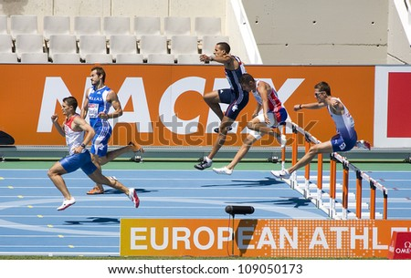BARCELONA, SPAIN - JULY 28: Competitors of 400 meters Hurdles Men Round 1 of the 20th European Athletics Championships at the Olympic Stadium on July 28, 2010, in Barcelona, Spain. - stock photo